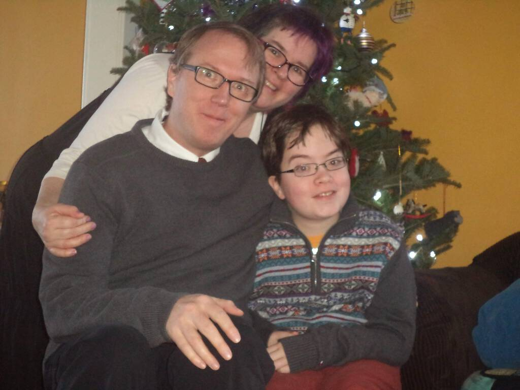 Our 2014 Family Christmas Photo, with me in grey sweater.