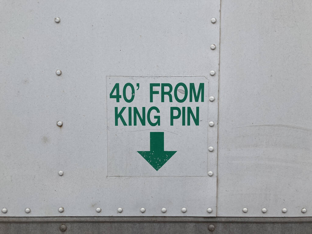 Photo of the sign on the side of a truck.