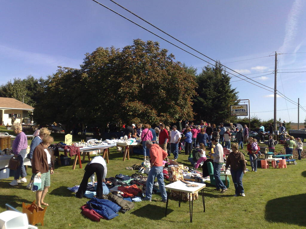 70 Mile Coast Yard Sale tables along the highway, with crowds of people