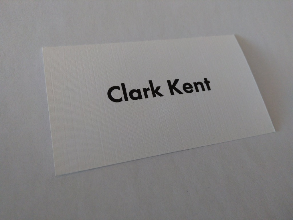 Clark Kent business card on textured paper