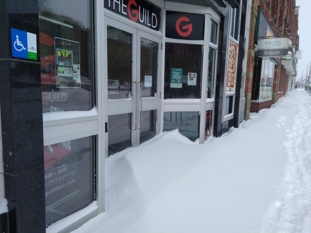 Photo of the front entrance of The Guild covered in snow.
