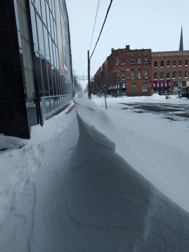 Photo of Richmond Street entrance to The Guild showing a pointy snow drift