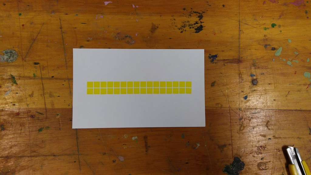 Photo of a single index card printed in yellow with squares