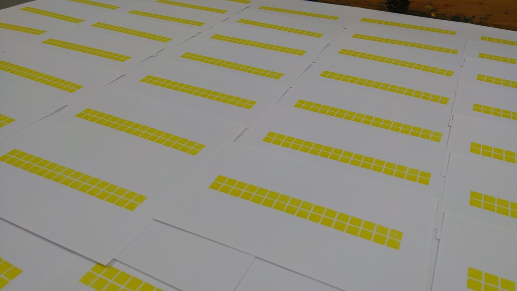 Photo of many yellow-printed index cards