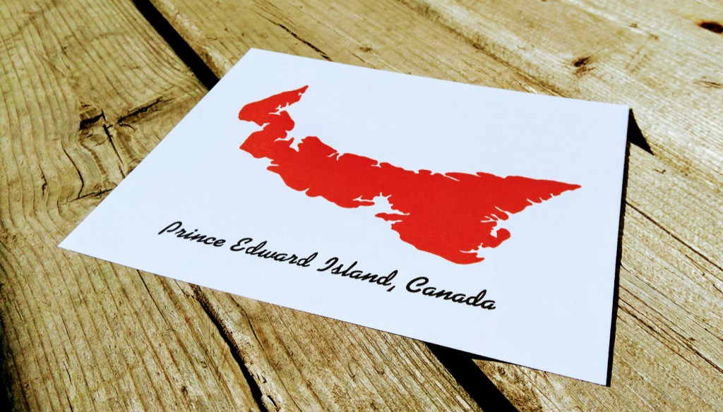 PEI Postcard (red outline of PEI with Prince Edward Island in Kaufman Bold typeface below)