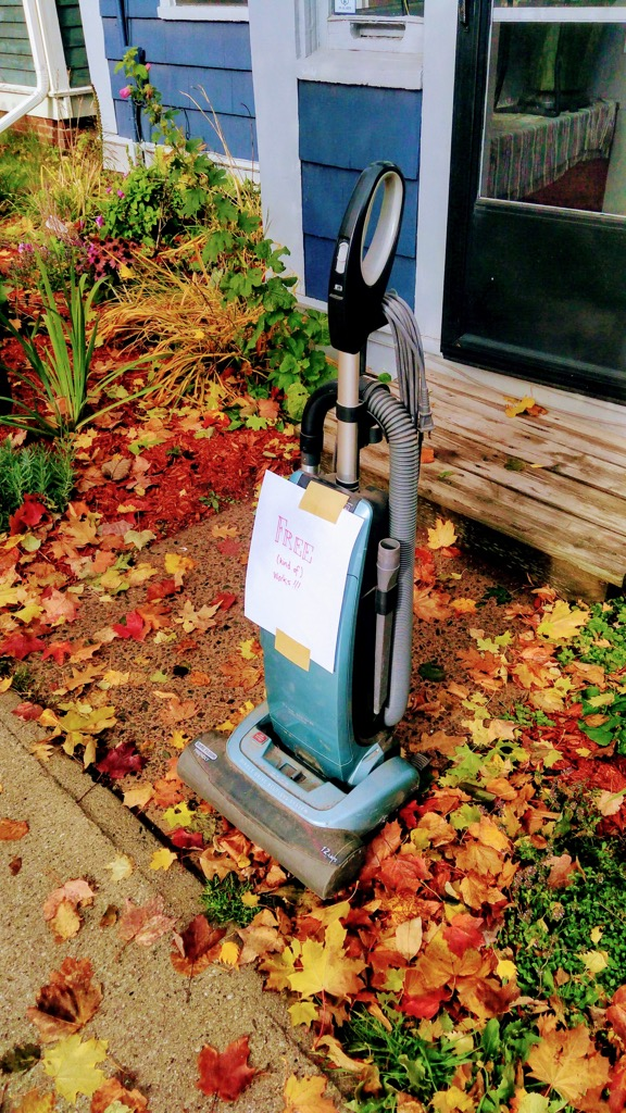 Photo of our old vacuum cleaner out for free on the sidewalk
