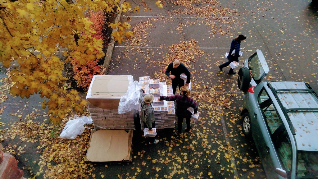 A photo of two palettes of The Buzz being unloaded.