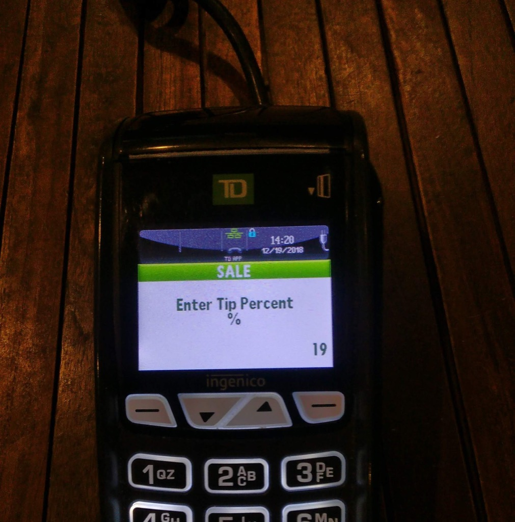 Photo of a debit machine at Mr. Sushi showing an 19% tip.
