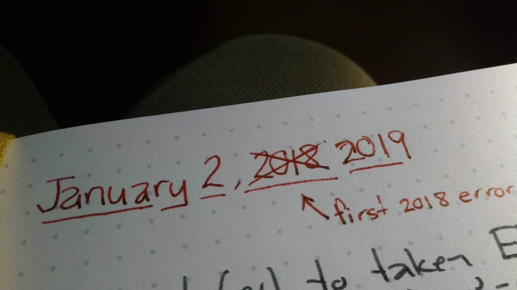Photo of corrected year in my daily journal.