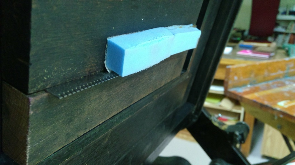 Photo of perf bar setup on letterpress.