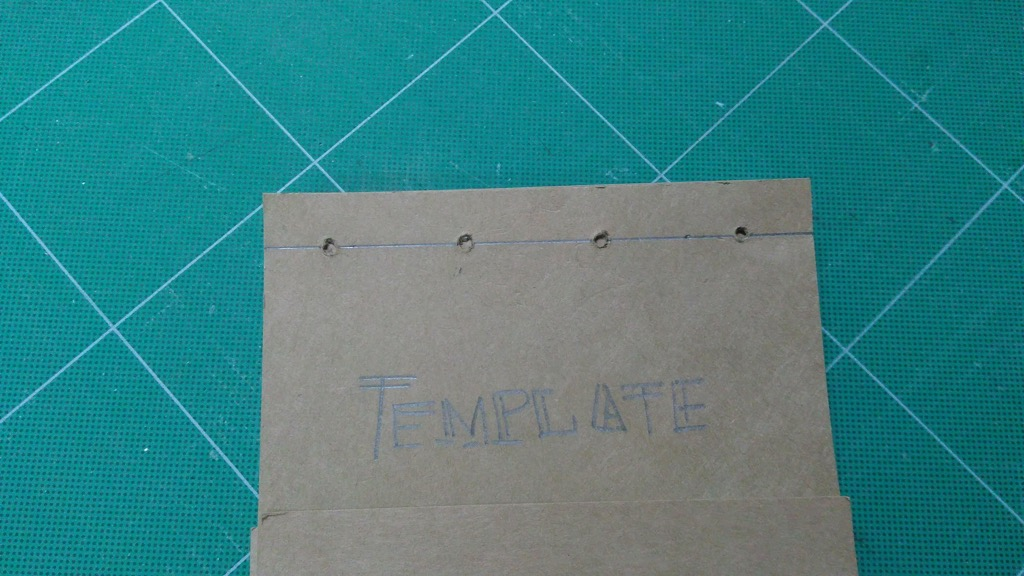 Photo of hole-punching template.