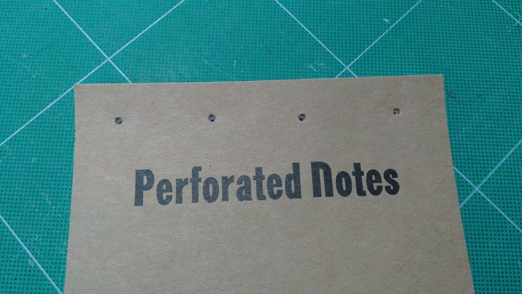 Photo of punched notebook front.