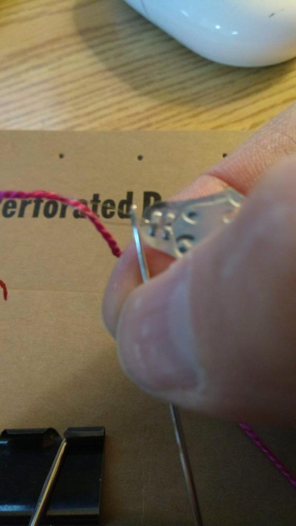 Photo of threading the needle