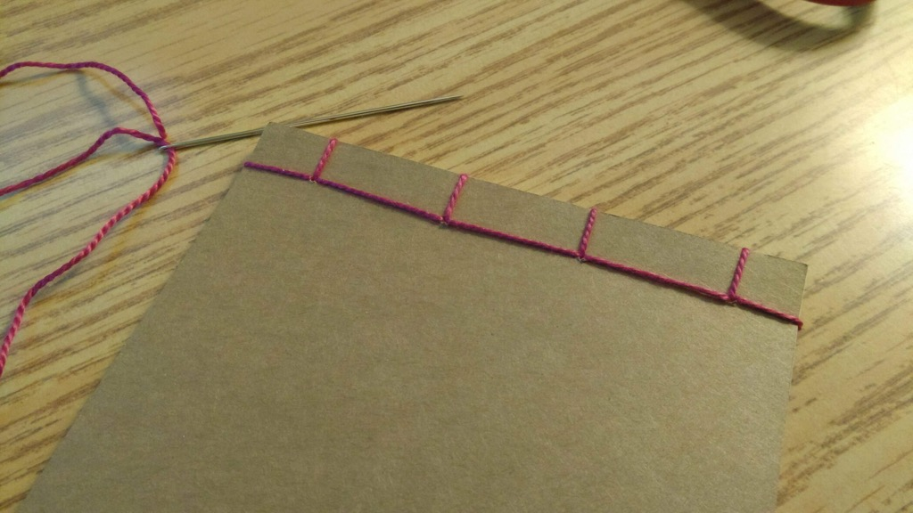 Photo of bound notebook from the back.