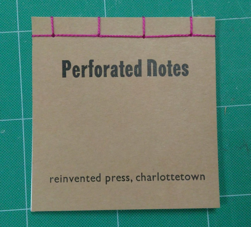 Photo of finished trimmed notebook.