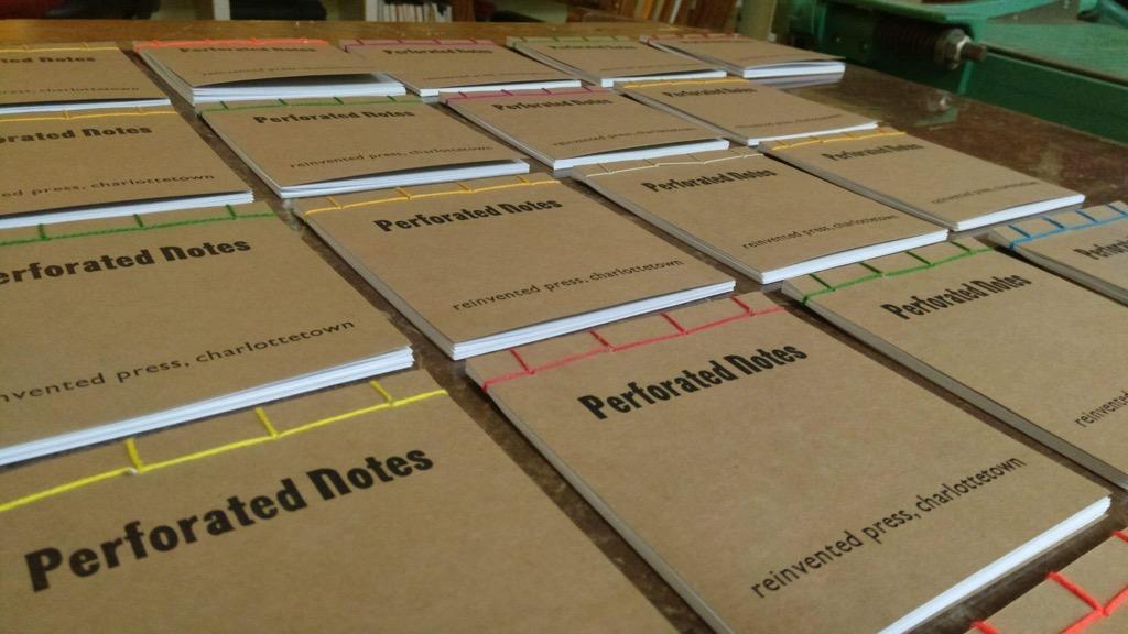 Photo of 23 bound notebooks.