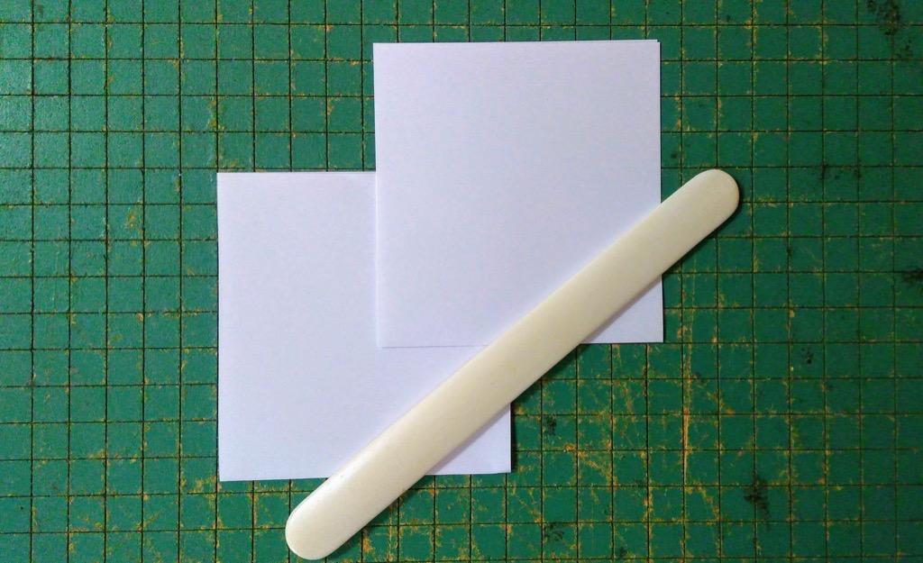 Photo of folded pieced, with bone folder.