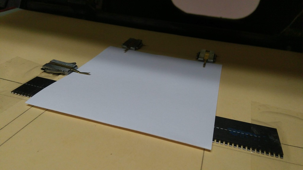 Photo of a signature on the press before perforating.