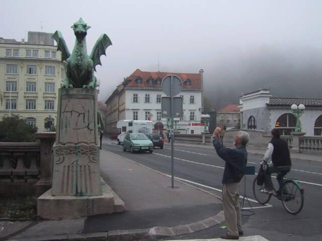 Dad taking a photo of Zmajski Most in Ljubljana.