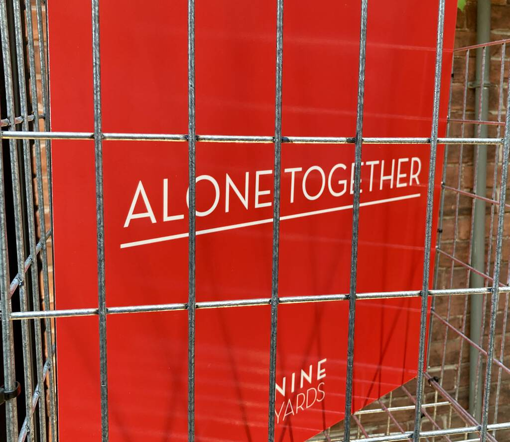 Alone Together sign, in a cage.