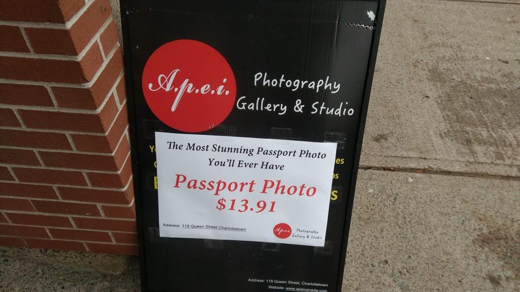 Sandwich Board for A.P.E.I. Passport Photos