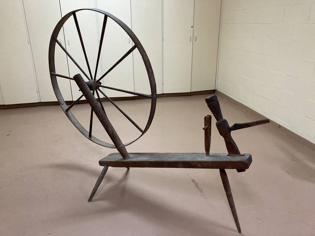 Photo of a Walking Wheel in a beige room.