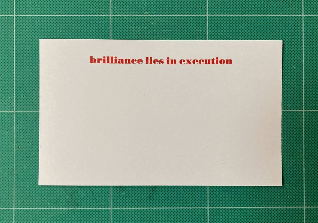 Brilliance lies in execution notecard, in red.