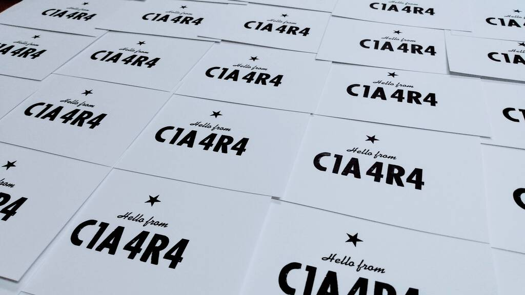 "Photo of drying ""Hello from C1A 4R4"" cards."