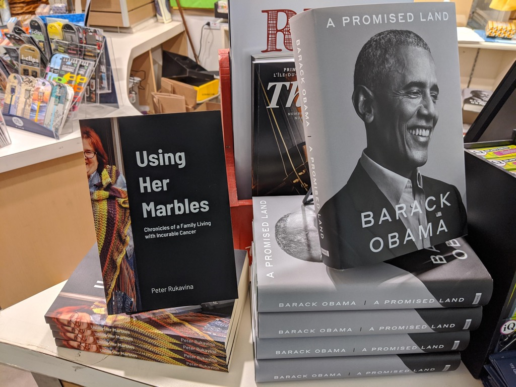Book table at The Bookmark, showing Using Her Marbles beside Barack Obama's  A Promised Land