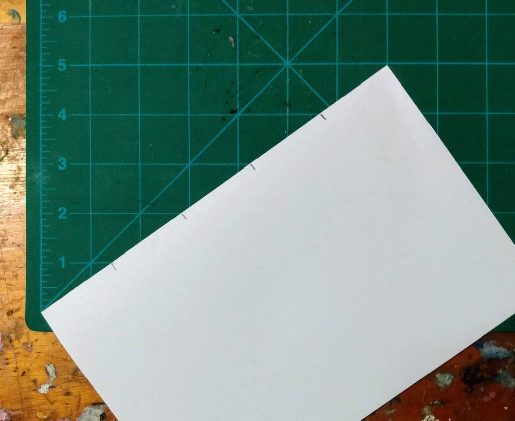 Dividing a piece of paper into five sections