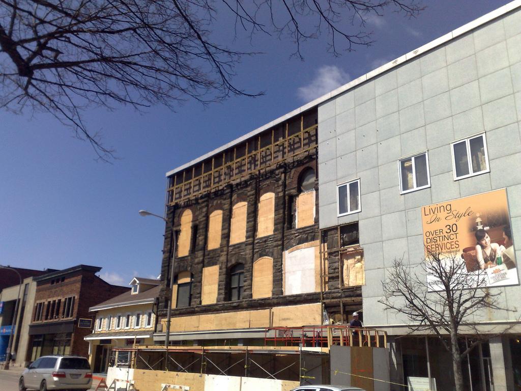 Holman Building Loses More Skin