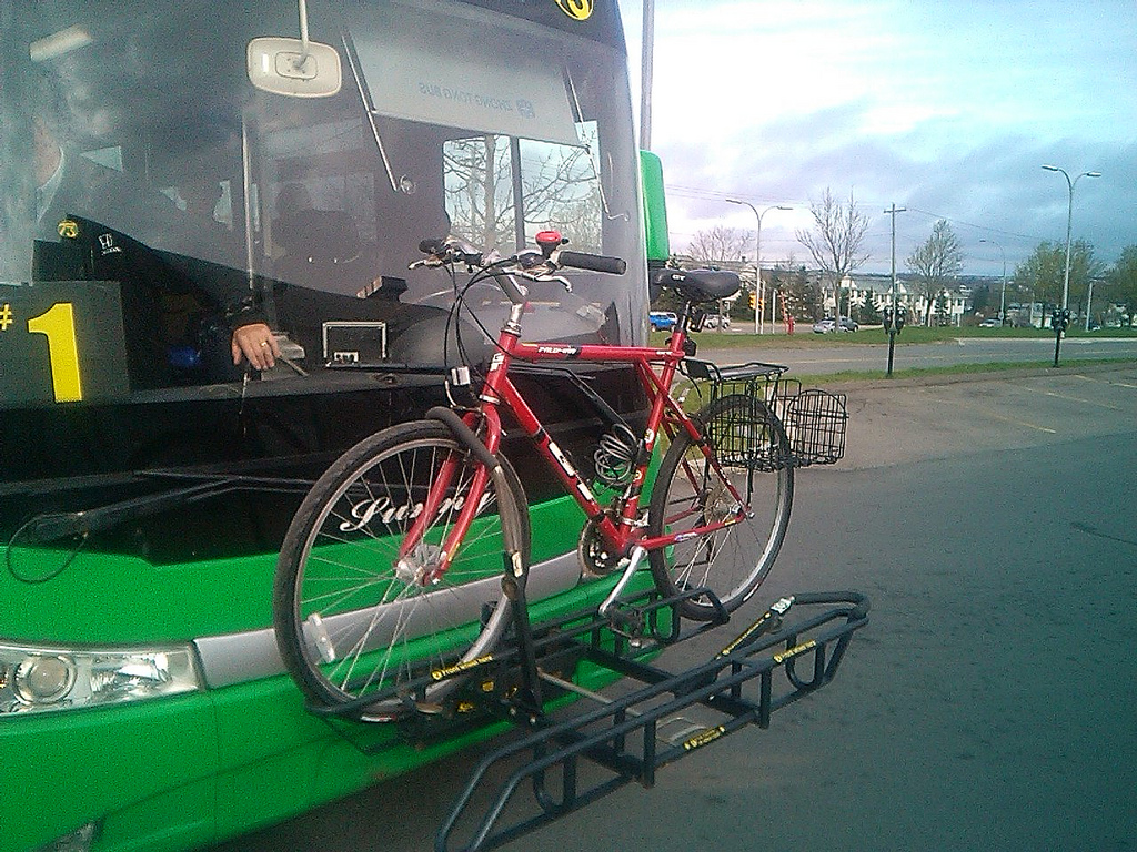 My bicycle in the bike rack on a T3 Transit bus.