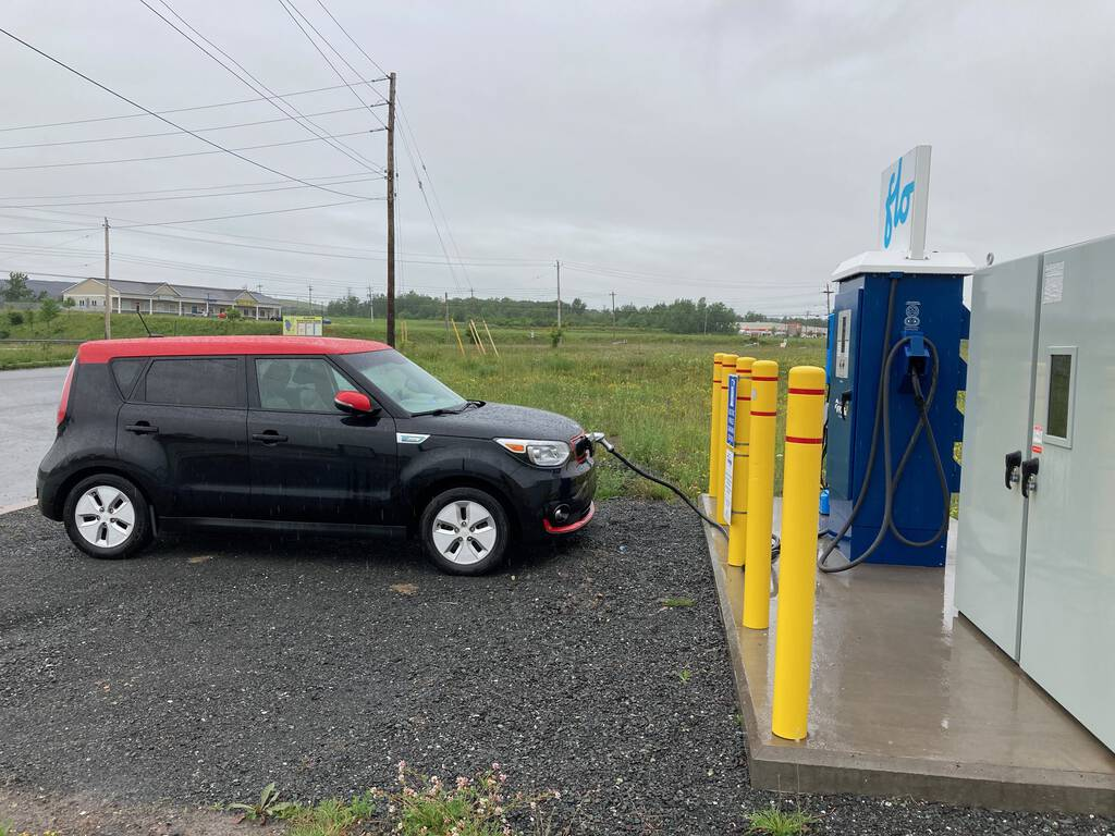 Our Kia Soul EV charging at the Flo charger in Stellarton, Nova Scotia on a rainy Monday.