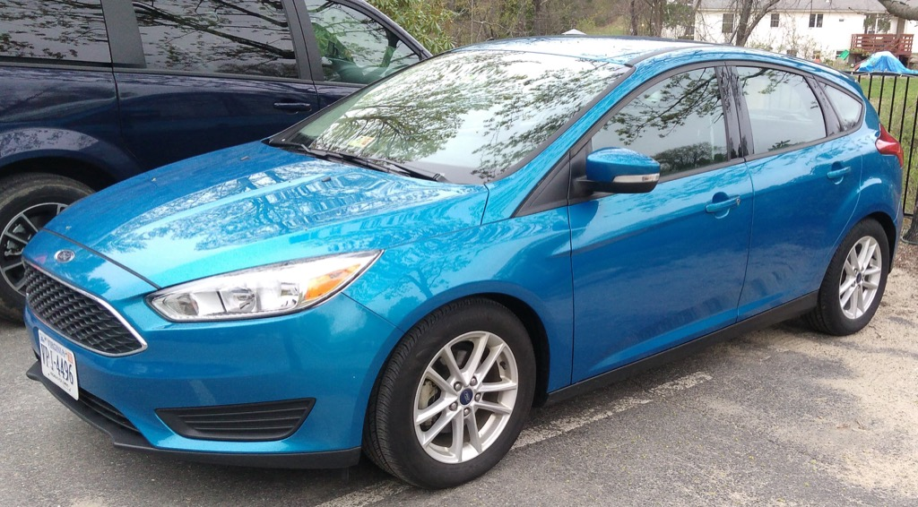 Photo of a blue Ford Focus rented from Hertz, taken from the side.