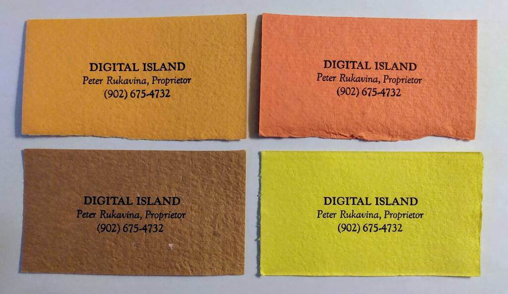 Photo of four business cards, in four different colours, for Digital Island, with my name and telephone number.
