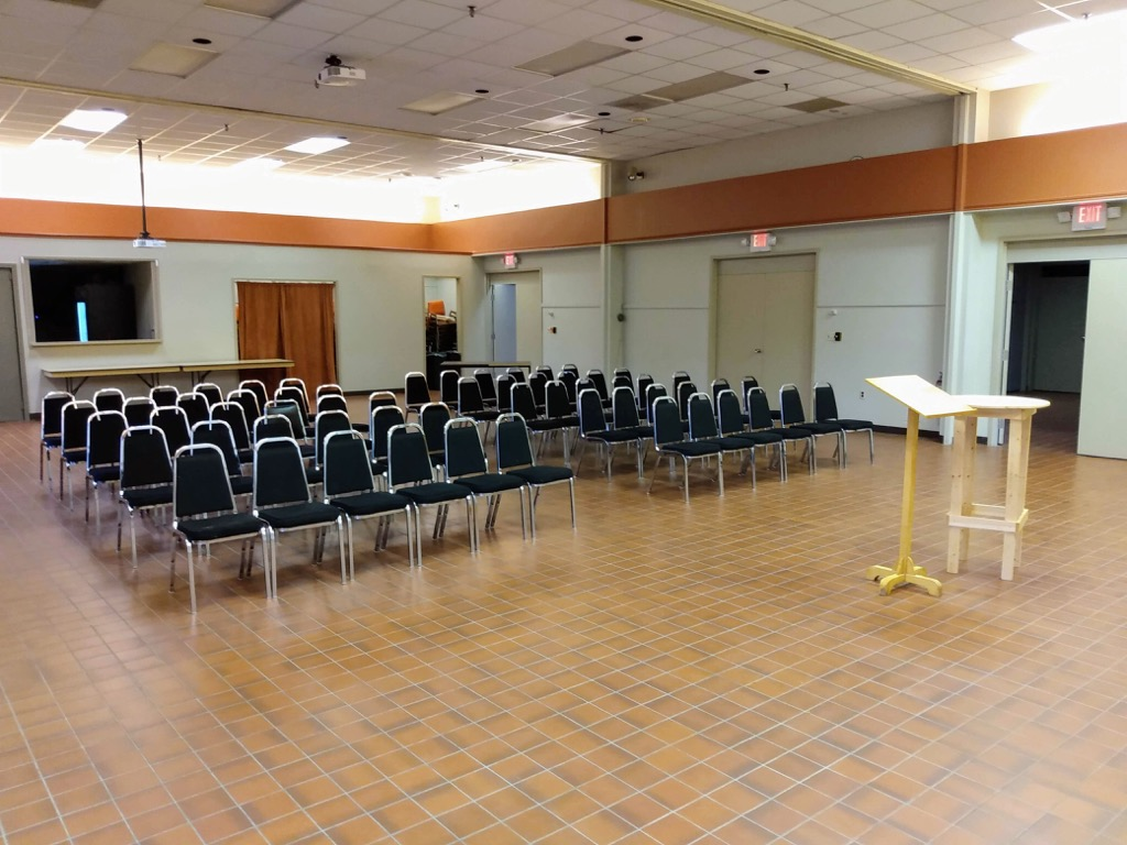 The Farm Centre meeting room with Green Party chairs set up.