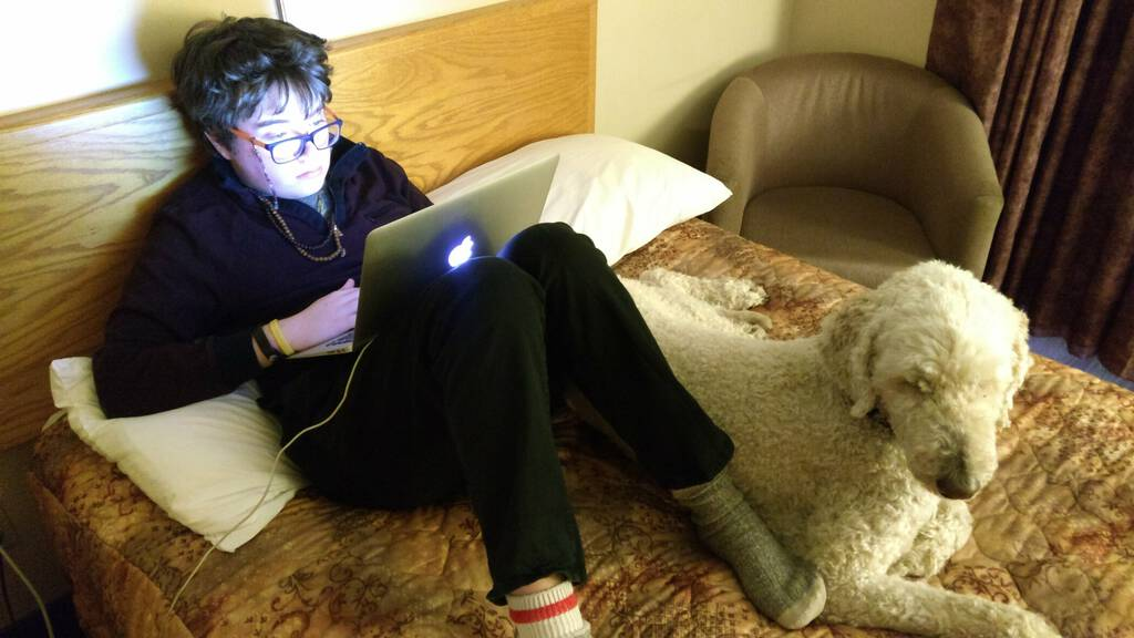 Ethan and Oliver at a hotel, computing