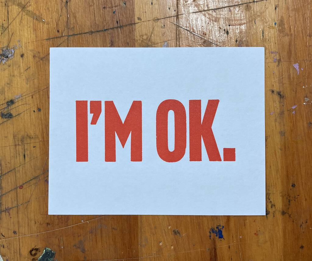 I'M OK, printed in declarative red.