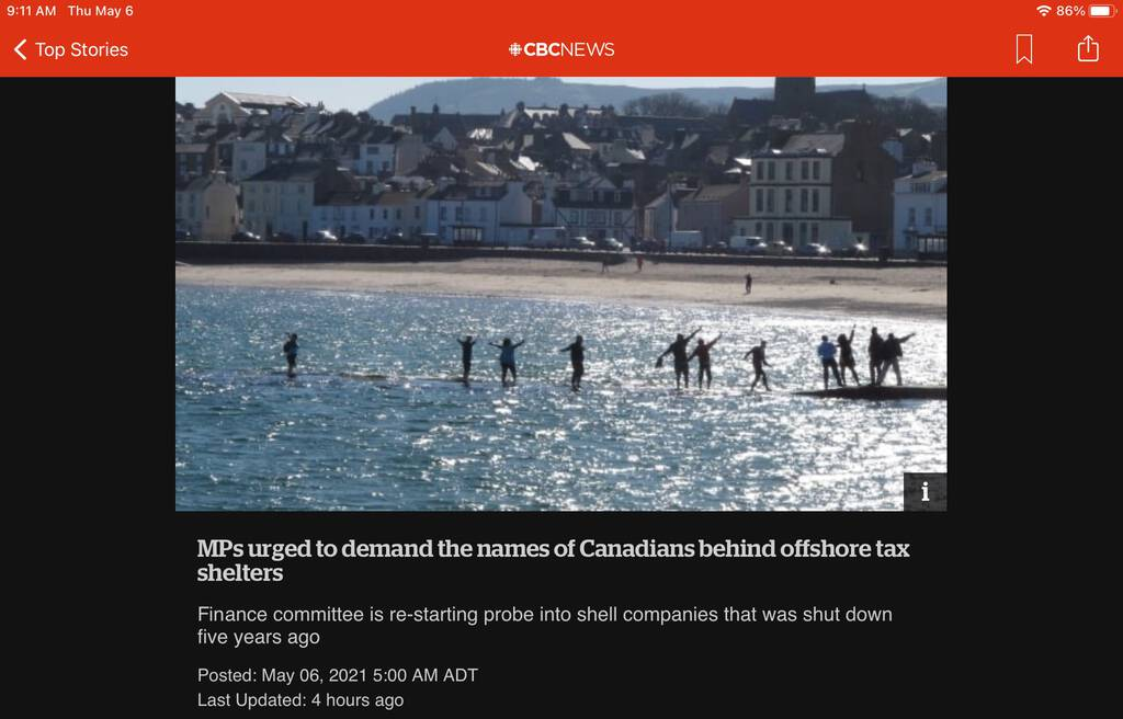 Screen shot from CBC News website showing photo of people appearing to walk on the water on the Isle of Man just offshore
