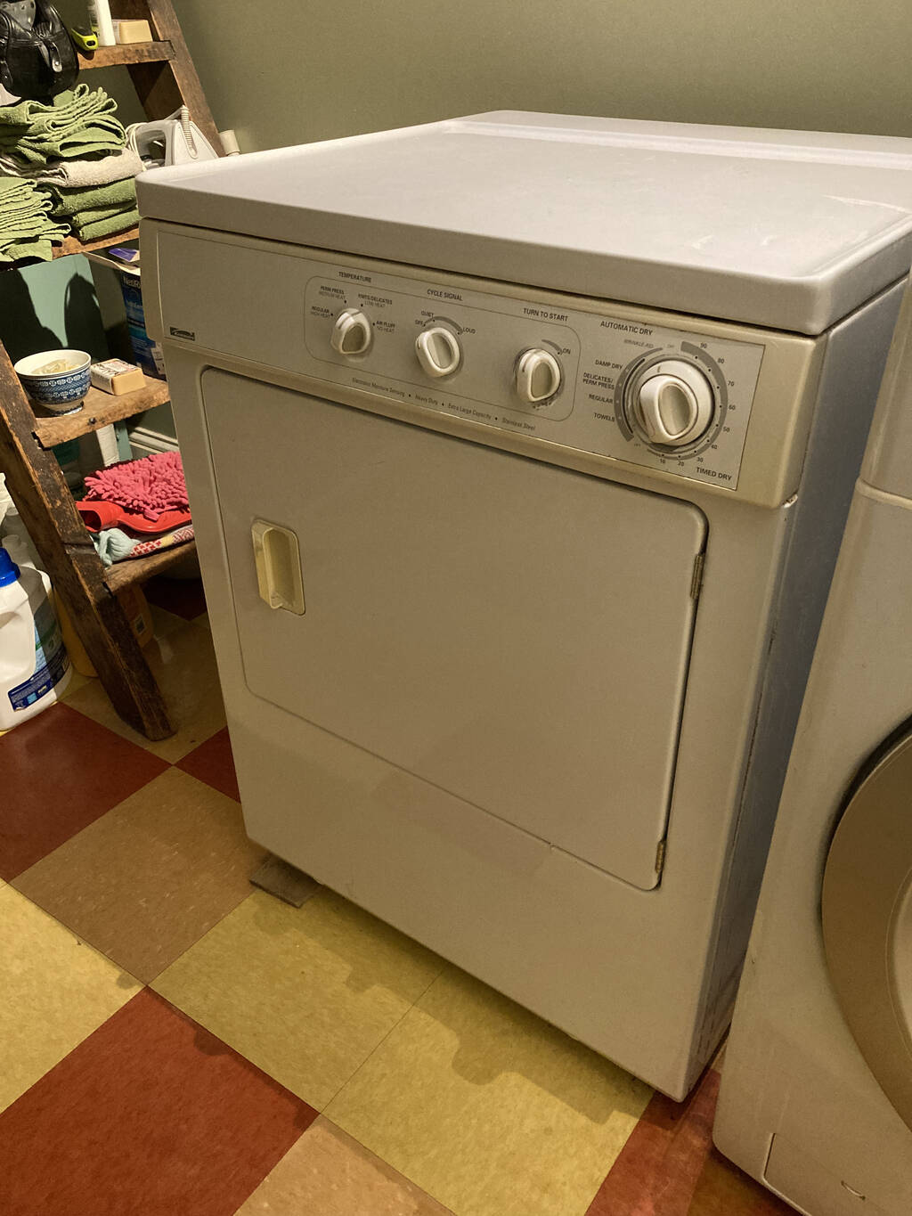 Our old Kenmore clothes dryer, in its space in our laundry room.