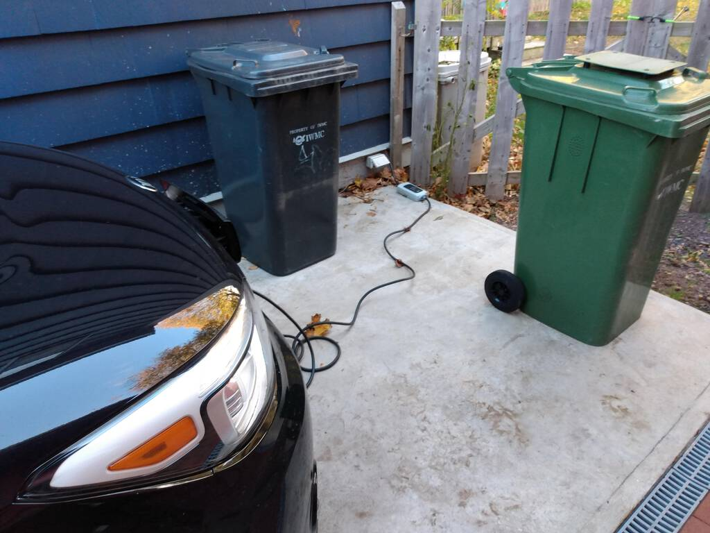 The Kia Soul EV charging from a regular outlet at our house.