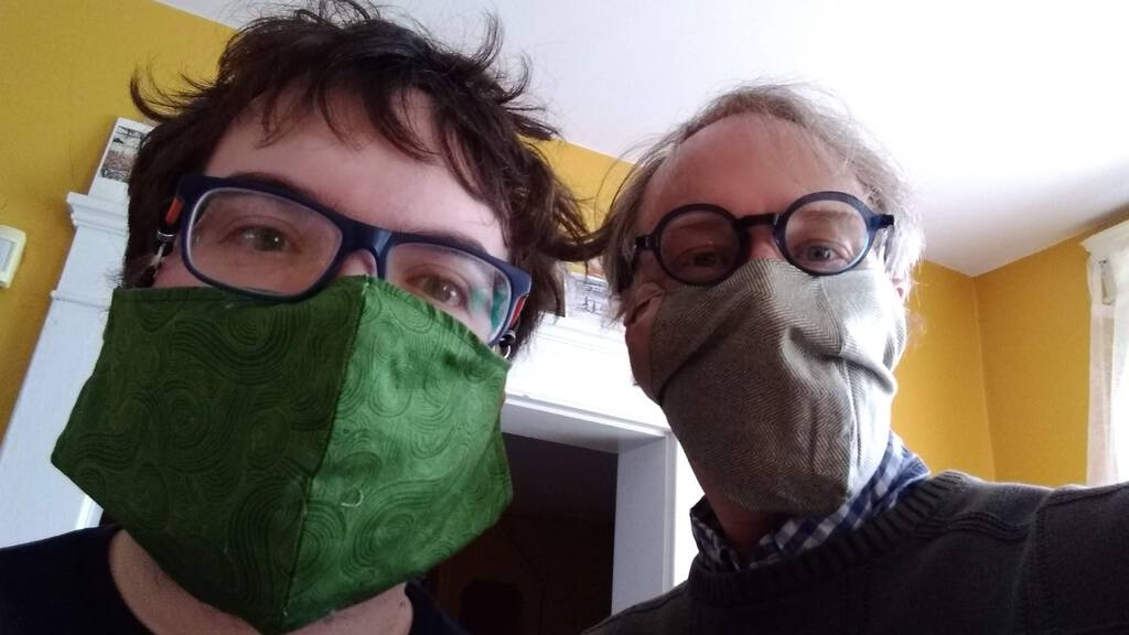Oliver and Peter wearing non-surgical masks.