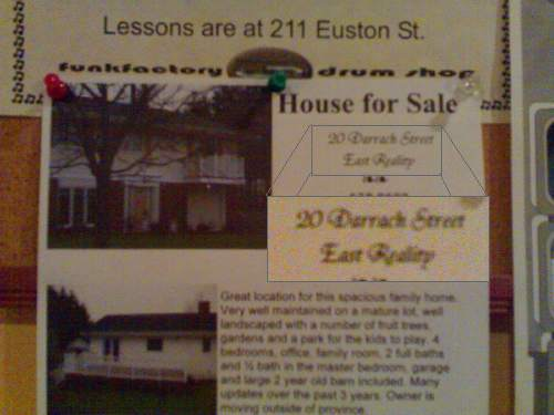 House for Sale Poster at Beanz in Charlottetown