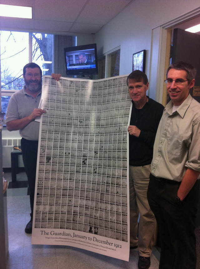 The Guardian Staff holding Guardian Poster