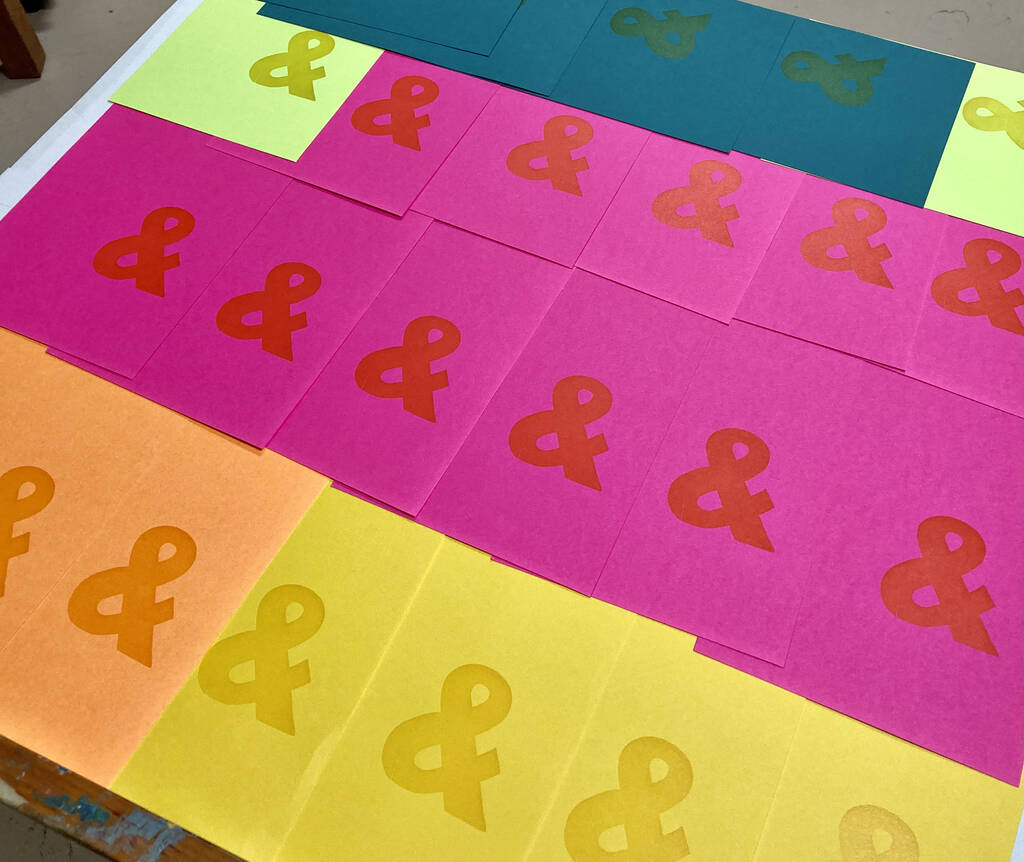 Yellow & on multicoloured paper.