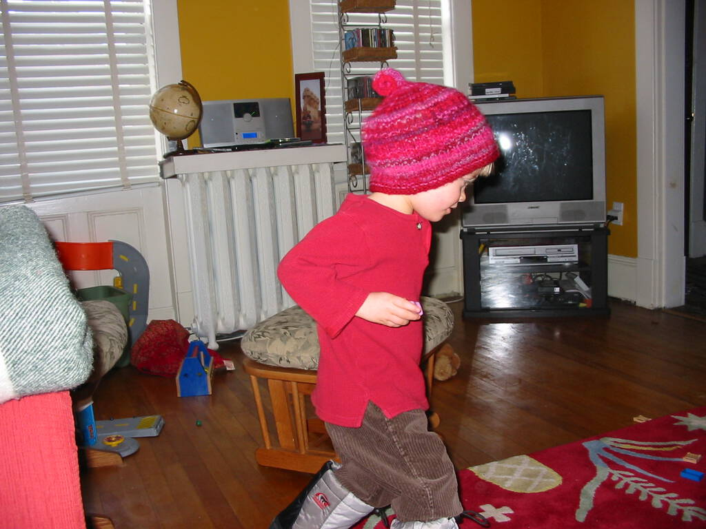 Oliver in front of the TV in winter boots in 2004