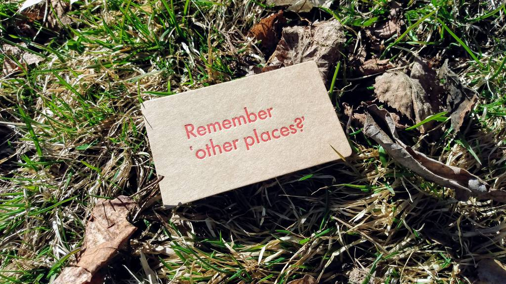 Remember 'other places?' printed in red on a brown card.