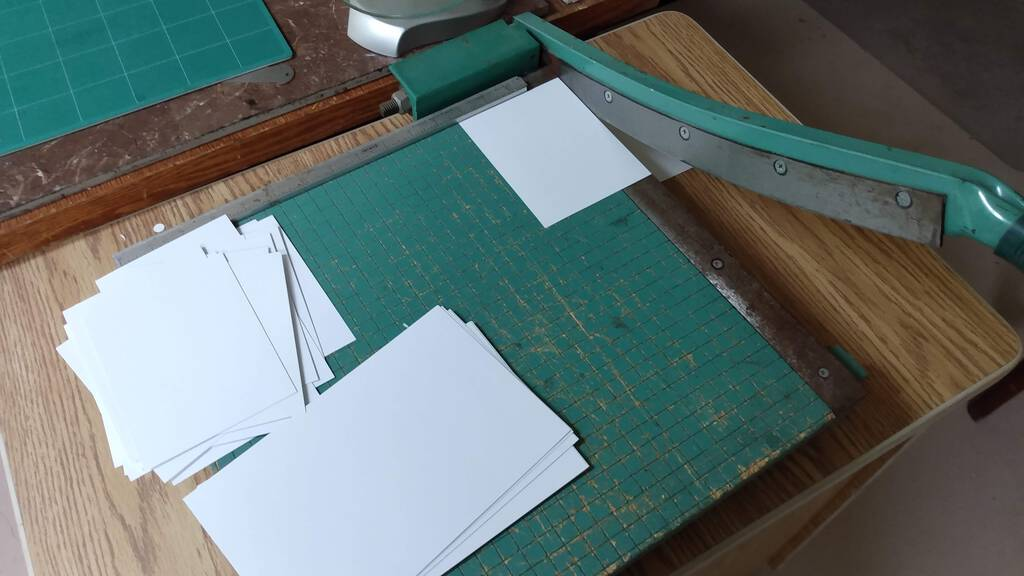 Slicing up paper on the paper cutter.