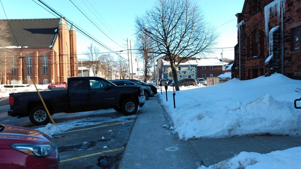 Cars and trucks blocking the Prince Street sidewalk.