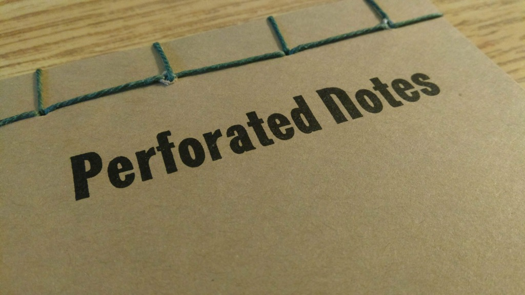 Photo of detail of stab binding of Perforated Notes book.